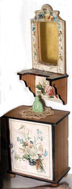 1890s German dollhouse scale; printed paper applied over natural wood with black painted borders on the cupboard and edging on the shelf below the mirror; above table top, 3 in. diameter with turned pedestal base in natural wood