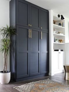 Black built-in cabinets. Perfect for a mudroom or laundry room. Those gold pulls are everything! Stunning Diy Kitchen Storage Solutions For Small Space And Space Saving Ideas No 01 Kitchen Storage Solutions, Diy Kitchen Storage, Laundry Room Storage, Laundry Rooms, Ikea Laundry, Storage Room, Living Room Storage Cabinets, Storage In Living Room, Ikea Kitchen Storage Cabinets