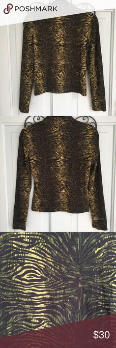 Etcetera Long Sleeve Mock Neck Zip Up Top Etcetera Long Sleeve Mock Neck Zip Up Top. Good used condition. So cute paired with black skinny jeans and heels. Zips up part way in the back. Open to offers. Etcetera Tops Blouses