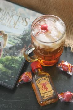 Firey cinnamon whiskey tamed by the sweet, smooth cream soda, punctuated with fireball candy. Fireball Cocktails, Princess Bride Wedding, Cinnamon Whiskey, Cream Soda, Bar Menu, Family Movie Night, Movie Party, The Breakfast Club, Sangria