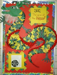 Fun dragon display for Chinese New Year. K students made all the scales with small triangles colored with various patterns.