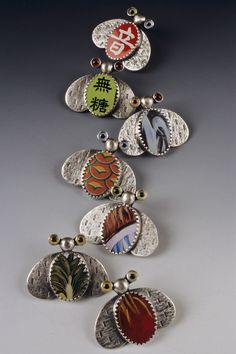SUSAN SKINNER / FIBULA STUDIO / Brooches / Assorted Bug Pins- Sterling, Lithographed Tin, Glass Eyes   .