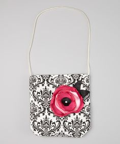This petite shoulder purse is portable sweetness. Its classic, girl-perfect shape and bold damask pattern make it perfect for everyday wear. 7'' W x 7.5'' H x 0.5'' D9.5'' shoulder dropPurse: 100% cotton Flower: polyester / plasticMade in the USA