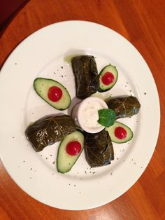 Dolmas Stuffed grape leaves with lamb