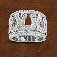 Lucky 7 and Lucky Horseshoes! The Kelly Herd Seven Horseshoe Ring is bold and bright and going to get noticed. Made of sterling silver, enhanced with Equestrian Jewelry, Horse Jewelry, Cowgirl Jewelry, Western Jewelry, Metal Jewelry, Silver Jewelry, Diamond Jewelry, Horse Necklace, Cheap Silver Rings