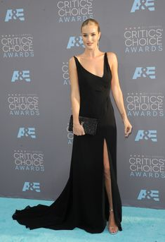 JANUARY 2016: Rosie Huntington-Whiteley attends the 2016 Critics Choice Awards wearing a black Saint Laurent dress. Photo: Tinseltown / Shutterstock.com