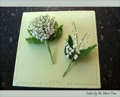 Handmade lily of the valley buttonhole and corsage made by me in sugar (gumpaste) as my entry in the Novice Floral class of the Sugarcraft North exhibition in 2011.  I won Bronze.