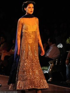 Michelle Singh walks the ramp for designer Manish Malhotra on Day 5 of Delhi Couture Week, held in New Delhi, on August 04, 2013.