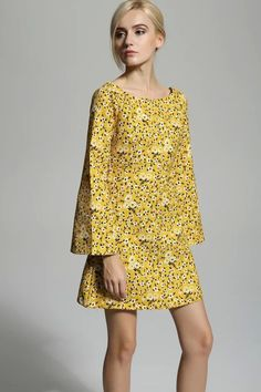 Make a statement in this dress featuring: round neckline, low back, flare sleeve, floral print, and fitted.