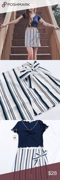 Striped skirt! How fun is this entire outfit? It is spring/summer approved & ready for your next vacay. Has a super cute bow that ties on the side! Striped skirt is lightweight has navy and pink stripes  Fabric is 70% cotton and 30% polyester. Model is 5'1 wearing a small. Skirts
