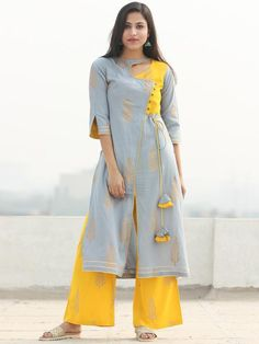 Embellished with golden hand block print, dori-latkan and buttons. Paired with Plazo Pant. Modern cuts and shape with trendy style and detailing. Plain Kurti Designs, Printed Kurti Designs, Silk Kurti Designs, Kurti Designs Party Wear, Sleeves Designs For Dresses, Dress Neck Designs, Blouse Designs, Kurta Neck Design, Kurti Sleeves Design