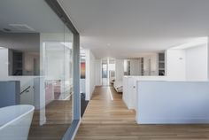 rzlbd > Instar House > master bedroom & ensuite > The third floor has been dedicated to a generous master bedroom with the sleeping zone on one side and a roof top patio on the opposite side where clients can enjoy an outdoor hot-tub while looking towards a beautiful park.
