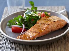 Salmon with Brown Sugar and Mustard Glaze : Bobby treats grilled salmon fillets to his sweet ginger glaze with Dijon mustard for some heat.