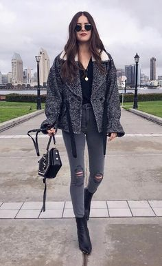Charcoal gray is the modern street style at its coolest. Stock up on this color with ripped jeans and a wrap winter coat to match your most-worn style staples. #winteroutfits #winterfashion #coat
