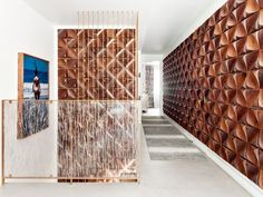 """Markus Bartenschlager at Bartenschlager Woodwork. """"wall panels are made of solid carved walnut in a custom design that was intended to mimic the budding of a flower, laid out on the wall to appear almost floating. 3d Geometric Shapes, Brooklyn, Entryway Stairs, Gravity Home, Home Trends, Tile Design, Textures Patterns, 3 D, Interior Design"""