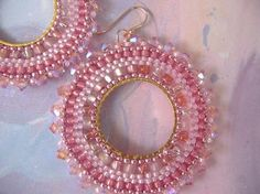 If you like to receive compliments on your jewelry, you will love these gorgeous earrings. I created these stunning earrings with multiple shades of pink 11/0, 8/0 and 6/0 seed beads and over fifty beautiful genuine Swarovski aurora borealis pink crystal beads. Each bead is individually expertly woven to make these beautiful earrings.