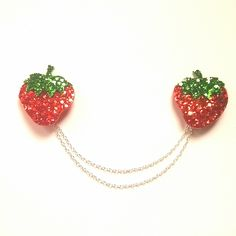 """Approximately 7"""" double chain with 2"""" strawberries and a silver attaching clip. Made from sturdy non-shed glitter fabric backed with soft felt."""