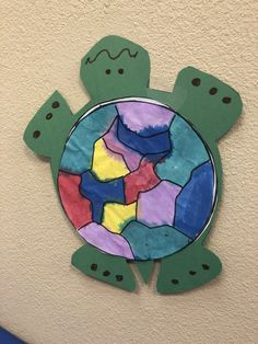 Kids cut out the circle first, then paint the circle to create a beautiful shell. Then glue onto the green construction paper turtle.