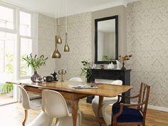 La sutileza y armonía de las formas y colores de este papel pintado harán de tu salón un espacio único.