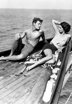 Joel McCrea and Kay Francis | Girls About Town | 1931 | love | vintage | romance | look | summer | sailor | water | sun | boat | relax | sailboat | black & white | date | 1930's | www.republicofyou.com.au
