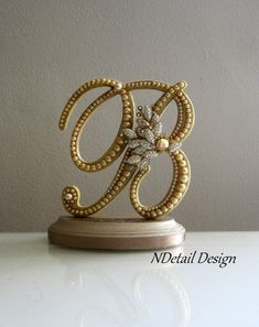 Love this caje topper...Wedding Cake Topper & Display Monogrammed Golden by NDetailDesign, $110.99