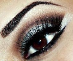 Sparkly Blue/Black/Brown/White eyeshadow.