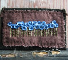 Blue flowers on a hand dyed brown background,