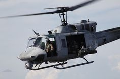 A UH-1N Huey from Marine Light Attack Helicopter Squadron 467 flies to Camp…