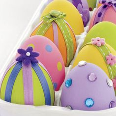 Beribboned Beauties  Dress up plain hard-boiled or blown-out eggs with paint and crafty trims. For easy polka dots, dip the eraser end of a ...