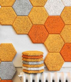 The wall is made up of tiles with textures that could be felt by touching them