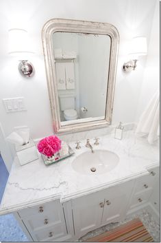Bathroom with pretty Louis Philippe mirror & marble counter & floor tiles - Munger Interiors