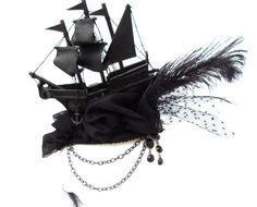 This black Gothic Pirate Fascinator is especially noble. 18th C Design.  There are black chiffon waves driven around by a restless ghost ship.  With a slightly firmer hat rubber band and hair comb at the bottom of this Marie Antoinette fascinator, it is able to be fitted easily and safely in any hairstyle / wig.  - Now this, I would wear:)
