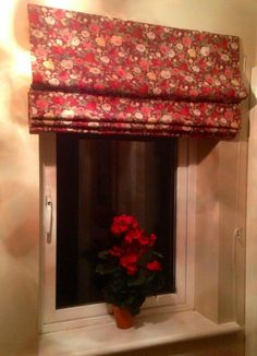 You can't beat a simple roman blind to add a bit of elegance to any window.