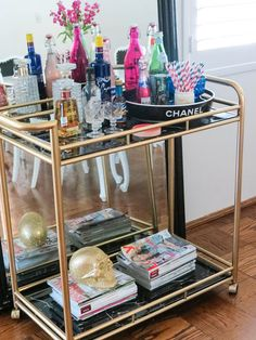 """Bar cart for bathroom storage. Towels and whatnot on the bottom shelves. Use the top as a bonus """"counter space""""."""