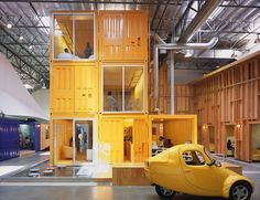 """7. Pallotta Teamworks - Los Angeles, USAClive Wilkinson Architects, who had come up with other creative solutions for warehouse spaces, conceived the idea to use shipping containers and large tents to create """"breathing islands"""" inside the warehouse. These self-contained air-conditioned islands of activity provide space for each department within the company and gives them each an identity."""