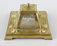 An Art Nouveau gilt metal and silver plated ink stand, with hinged cover…