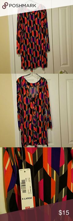Dropped neck with tie dress Multi colored dress with dropped neck in the back with ties. Never worn. Long sleeves. Light rayon material. Allen B Dresses Long Sleeve