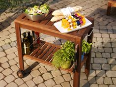 ÄPPLARÖ outdoor serving cart is equipped with a rack for bottles, keeping them in place.