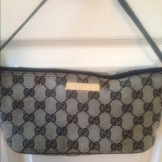 Gucci grey and black pouch bag Guc Gucci black leather trim made in Italy stamped and could also be used as a fabulous makeup bag. Could use a little spot cleaning on bottom of bag. Great bag no rips or stains. Silver hardware Gucci metal logo on front of bag. Gucci Bags Mini Bags