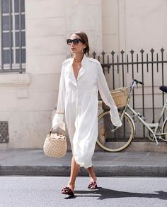 Photo via:  @Louloudesaison There are 3 items every fashion obsessed girl loves for the summer season; unique slides, a cozy, oversized shirt dress, and a basket tote. This fashion consultant wore all