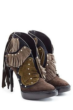 Burberry Prorsum is always one step ahead, and we love the tactile craftsmanship of these fringe-detailed suede booties. The elevating platform is a smart choice next to the pin-thin stiletto heel, while neutral brown and khaki tones make them perfect with pitch black #Stylebop