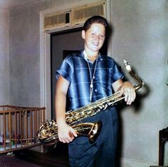 A 12 year old Bill Clinton with his tenor saxophone.