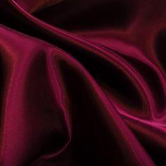 Forro de Raso Rayón Granate. Forro de raso de rayón de color granate. La tela de Rayón, es un tejido de gran calidad y con acabado satinado muy elagante, suave, ligero y totalmente transpirable. El tejido de forro de raso, es utilizado para forrar todo tipo de prendas ya sea a modo de protección o para evitar transparencias no deseadas. Tela ideal para usar como forro de vestidos, forros de chaqueta, forro de abrigo, forro para bolsos, y más.