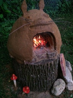 The first firing of our Totoro mini cob oven. He's a great addition to our daughter's garden.