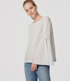 In fine striped cotton, this bell sleeved piece is a beguiling beauty. Round neck. Long bell sleeves. Back keyhole with button closure. Side slits.