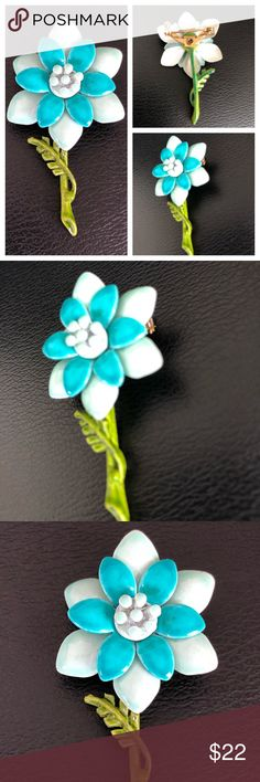 """Small Retro Enamel Flower Brooch in Blue Such a dainty-size retro vintage flower brooch pin enameled in two-tone blue, while a green stem and leaf provide additional visual interest. Not so much seen on the smaller scale, this little beauty measures 2"""" x 1"""".  In excellent preowned vintage condition. Smoke-free home. Vintage Jewelry Brooches"""