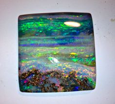 boulder opal - looks like the sky, the ocean and the sand - spectacular!
