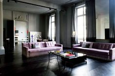 Pink, used in a way that is definitely not girly, in this Parisian living room.  #Joseph Dirand Pink Couch | Remodelista