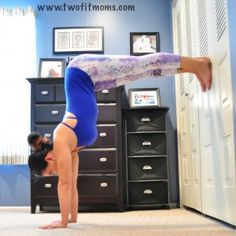 Handstands 101: Building Your Foundation: Suck your bottom ribs in by not dumping into your chest. Keep your legs engaged, feet pushing into the wall! , you can start to play with lifting one leg actively into the air. Keep the hips square towards the wall and the inner thigh rolling in.