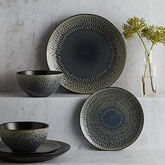 Crafted from earthenware, this beautiful blue 12 piece dinner set is an elegant addition to any dining table setting. Featuring an embossed reactive glaze finis. Dinner Sets Uk, Dinner Plate Sets, Ceramic Decor, Ceramic Plates, Dinnerware Sets Uk, Black Dinner, Leather Tray, Black Bowl, Plates And Bowls